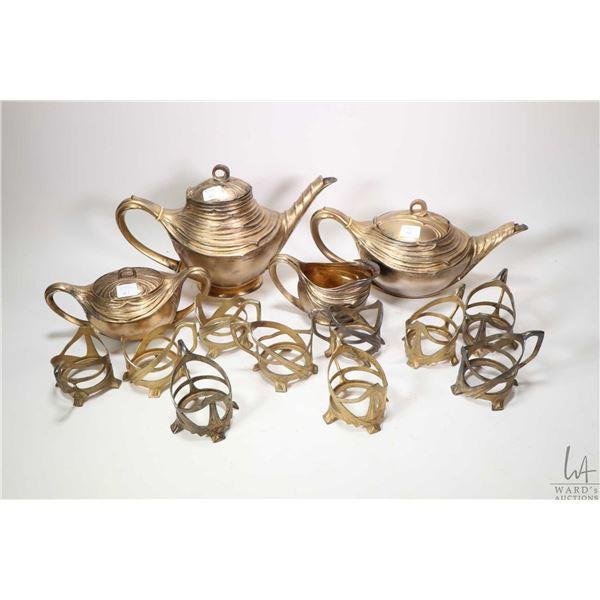 Antique German made WMF Art Nouveau gilt tea set including tea pot, coffee pot, cream and open sugar