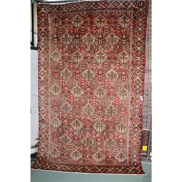 100% Iranian Bakhtar area carpet with overall geometric design, red background and highlights of cre