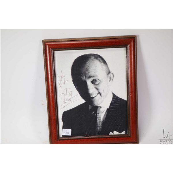Collection of wall art including hand signed black and white photograph of Yo-Yo Ma and a original e