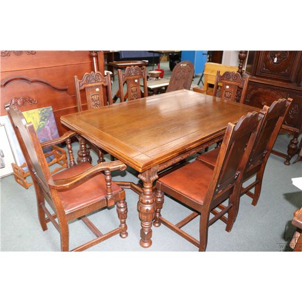 Antique oak refectory draw leaf dining table with six matching dining chairs including one carver