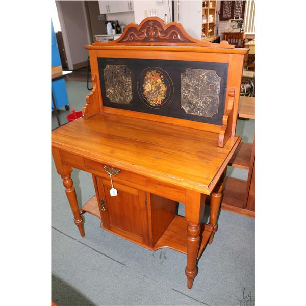 Antique single door washstand with hand painted slate back and nouveau influenced carved topper