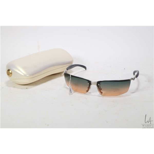 Pair of vintage Chanel sunglasses in Chanel case