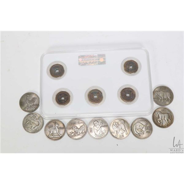 Set of five Oriental tokens in sealed case plus a collection of nine Oriental Zodiac animal tokens