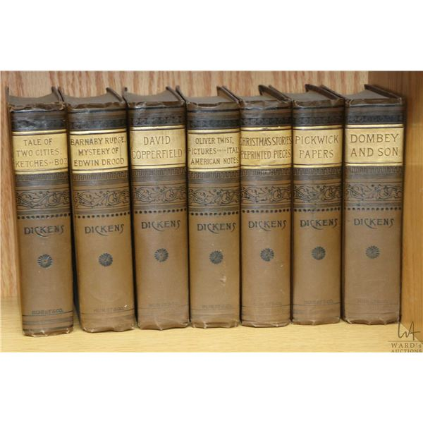 Seven vintage volumes of Charles Dickens stories published by Hurst & Co. Publisher, New York includ