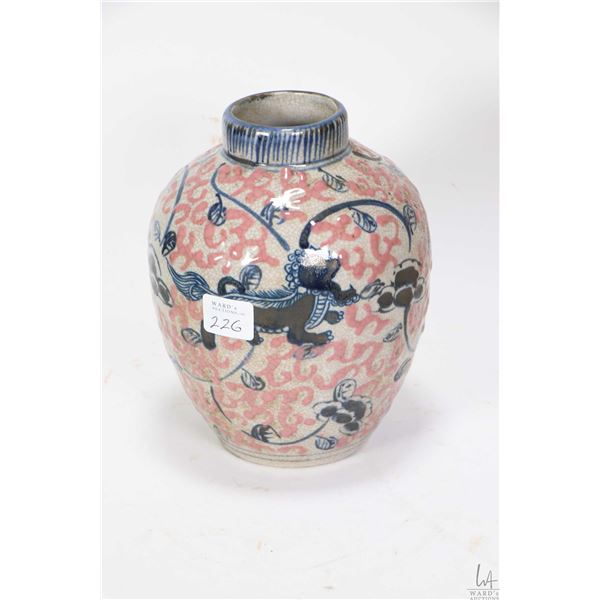 """Blue and pink glazed """"Buddhism Lion"""" jar with purportedly Heaven base mark, 7"""" in height. Not Availa"""