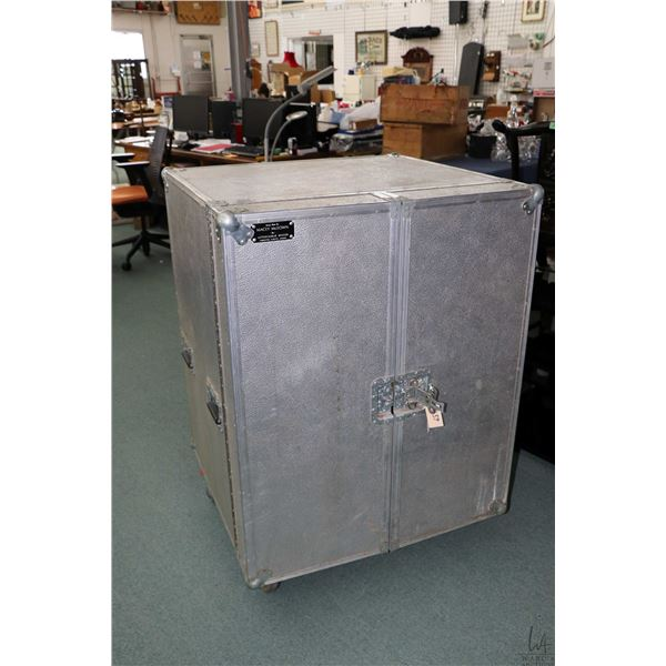 Custom made saddle and tack road case with saddle storage, four drawers and door cubbies on heavy du