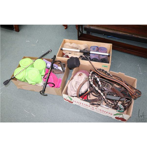 Selection of riding tack and accessories including four sets of four leg wraps, riding crop, selecti