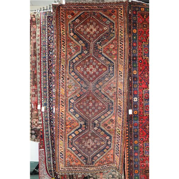 100% Iranian Shiraz area carpet with multiple medallions, overall floral design in shades of brown,