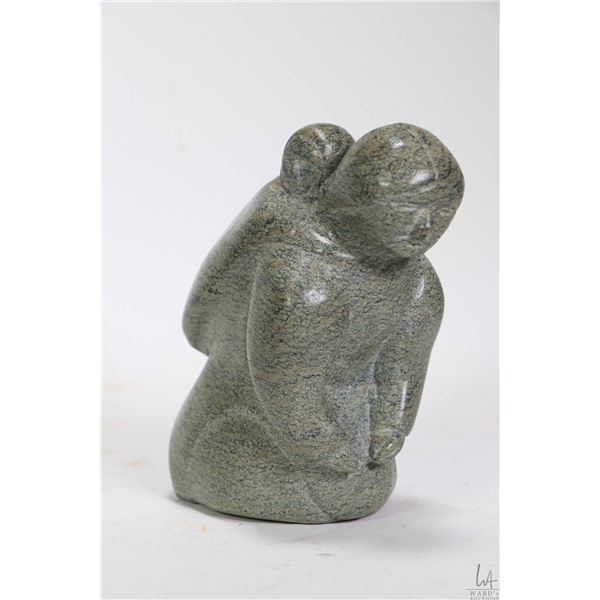 """Inuit soapstone carving of a mother and child no artist signature seen, 4 3/4"""" in height"""