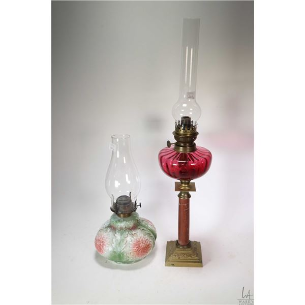 Two vintage oil lamps including Kosmos-Brenner lamp with cranberry font, cast and marble like base w