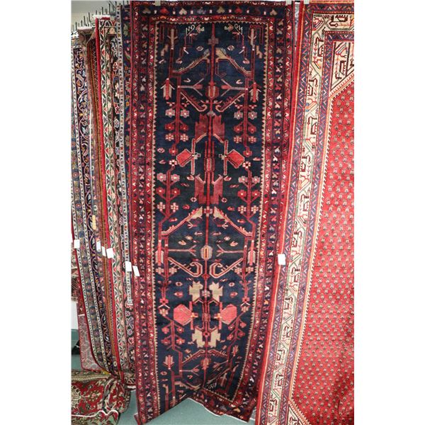 100% Iranian Hamaden carpet runner with center medallion, dark blue background, overall floral desig