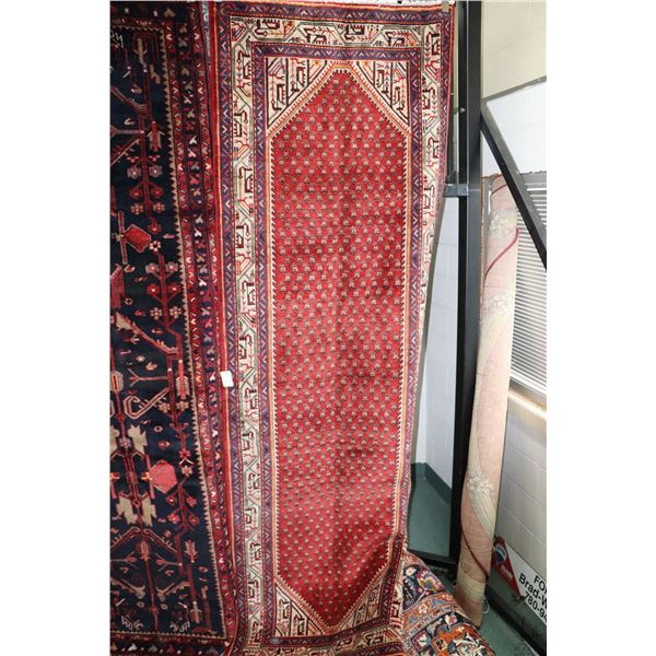 100% Iranian Mir carpet runner with overall geometric pattern, multiple border, red background and h