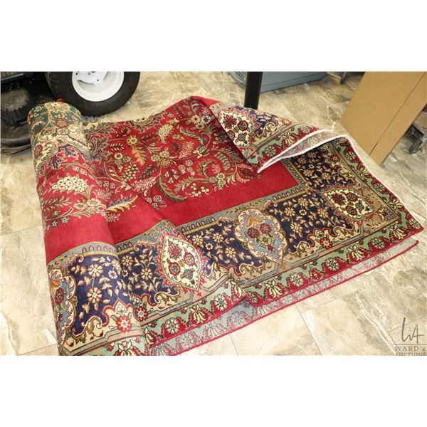 100% Iranian hand made Tabriz area carpet with red background, floral design and highlights of blues