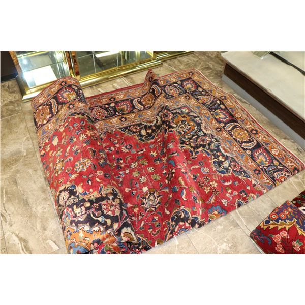 100% Iranian Mashad area carpet with red background, overall floral design and highlights of greens,