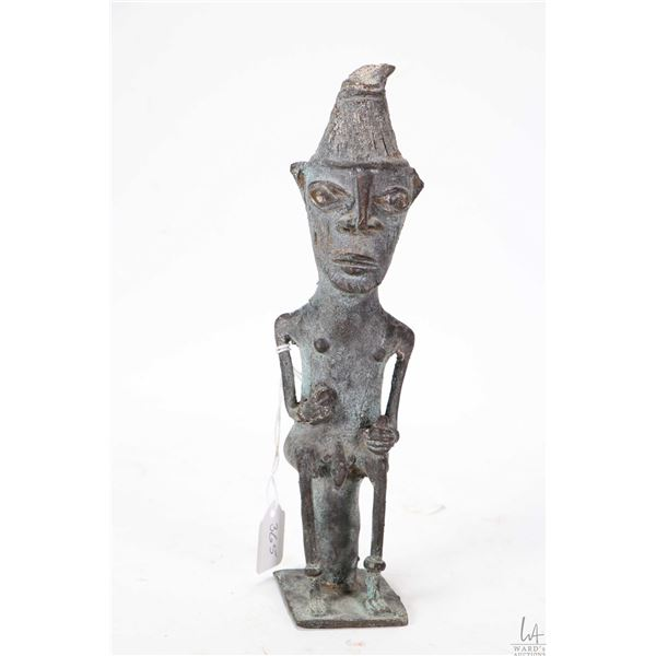 """Cast bronze sculpture of a male tribal figure seated, initialled by artist 9""""-purportedly purchased"""