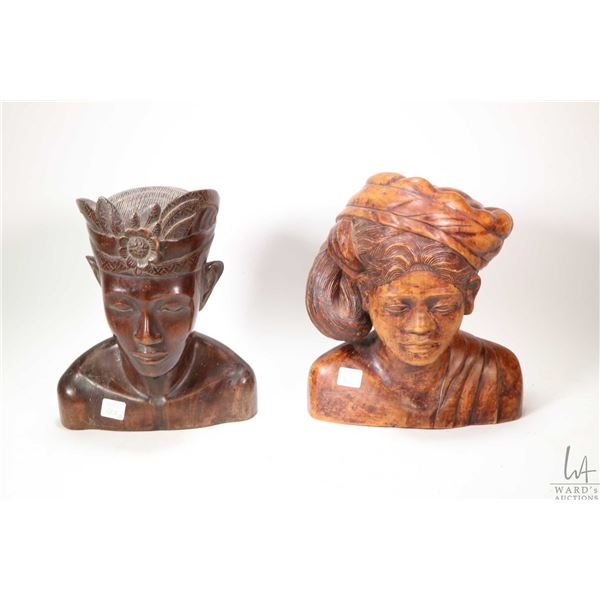 """Two hand carved treen ware busts including Asian head with head dress 10 1/2"""" in height and an Asian"""