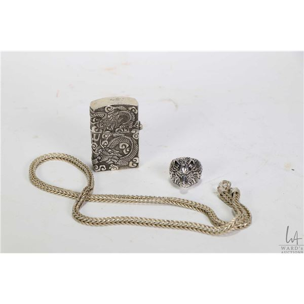 White metal necklace, dragon lighter and wolf motif ring