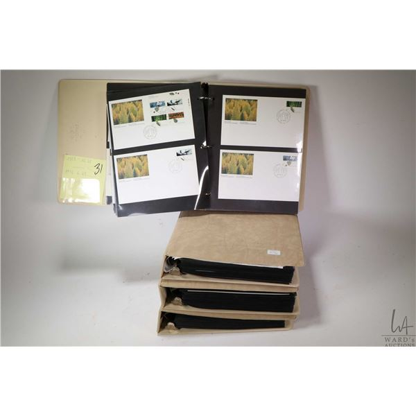 Four binders containing First Day issue Canada Post Stamps (1989-1997) approximately 120 covers per