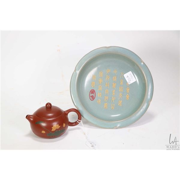 """Small """"Rythm of Lotus"""" purple clay teapot and a parcel-gilt Celadon foliate dish 7"""" in diameter"""