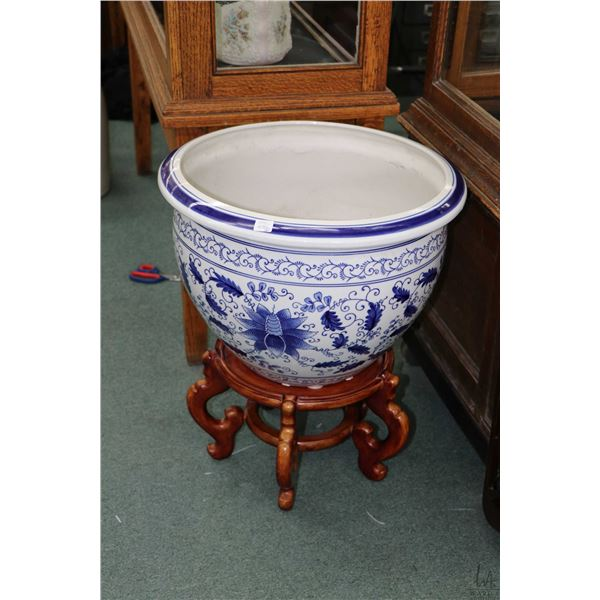 """Two matching blue and white large planters on wooden stands, each 19"""" in diameter. Not Available For"""