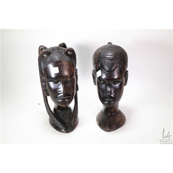 Two hand carved African bust including male figure and female, initialled by artist  -note purported