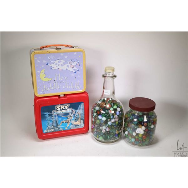 Two glass jars of vintage marbles plus two vintage lunch boxes