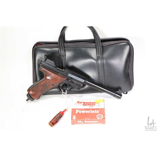 Vintage Crossman .22 calibre Mark I air pistol with original case and a package containing two CO2 p