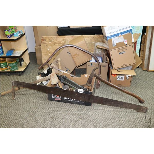 """Selection of vintage and used tools including a 68"""" double handled bucksaw, a bow saw, axes, hammers"""