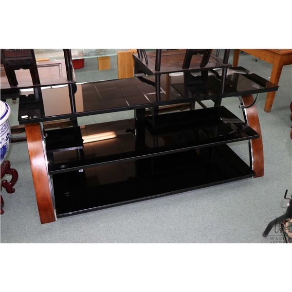 """Three tier smoke glass and wood flat television stand, 54"""" wide"""