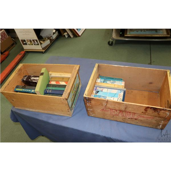 Two vintage wooden fruit case with a selection of vintage soft and hardcover books including nine Lu