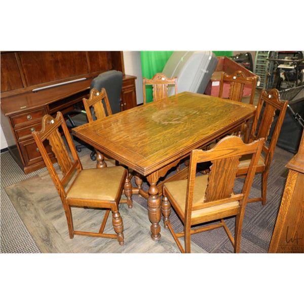 Refectory style oak draw leaf table with six dining chairs including one carver