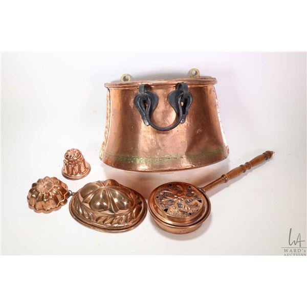 Selection of copper including miniature bed warmer, moulds and a wall mount kindling box