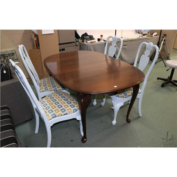 Four Queen Anne style dining chairs on cabriole supports and Queen Anne style table, all made by Eth