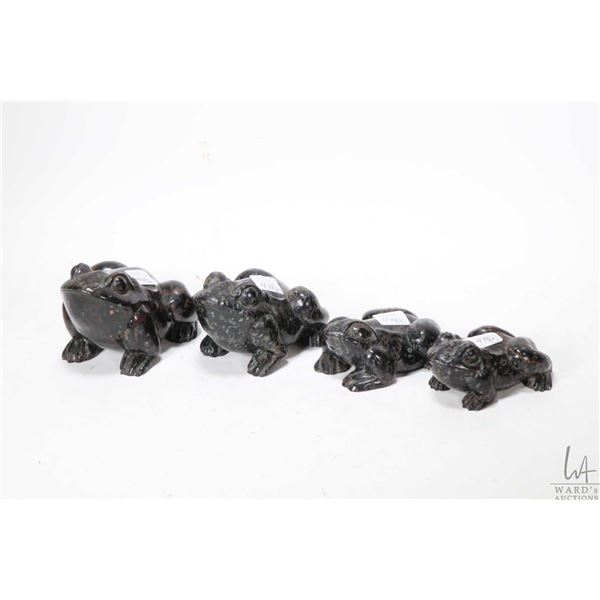 Four carved frogs ranging from 4  to 5
