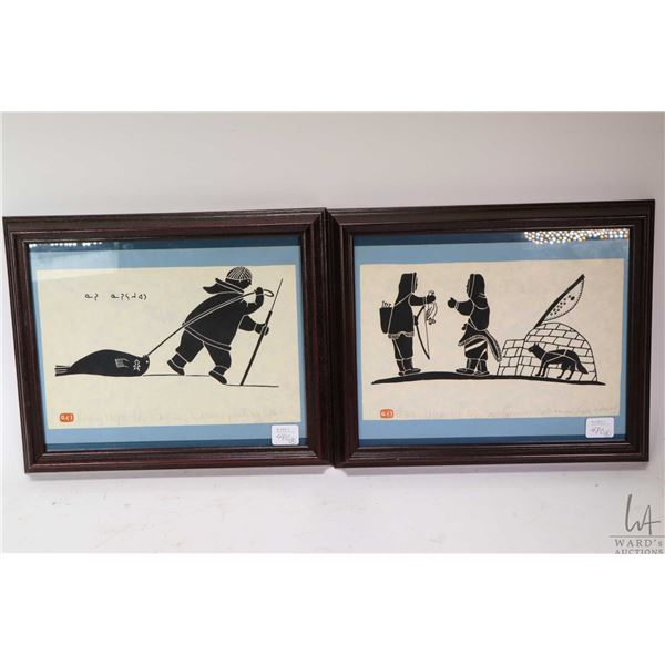 """Two framed Inuit prints including """"Eskimo Returning from a Hunt"""" and """"Eskimo Pulling Seal"""" both penc"""