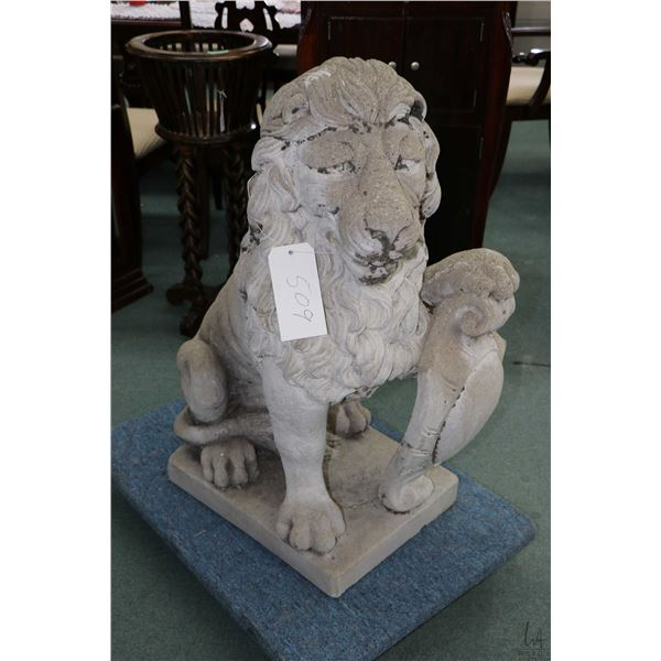Concrete seated lion with shield, 34  in height, facing right, Not Available For Shipping. Local Pic