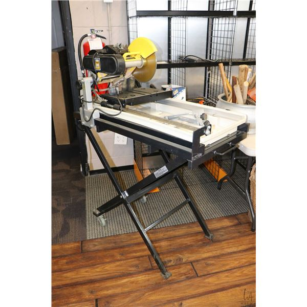 Power Fist wet tile saw on floor stand, working at time of cataloguing