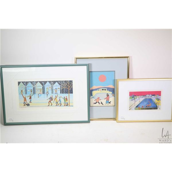 Three framed print including one Ted Harrison