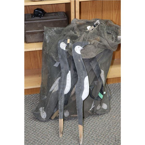 Mesh sack containing a selection of vintage wooden duck decoys