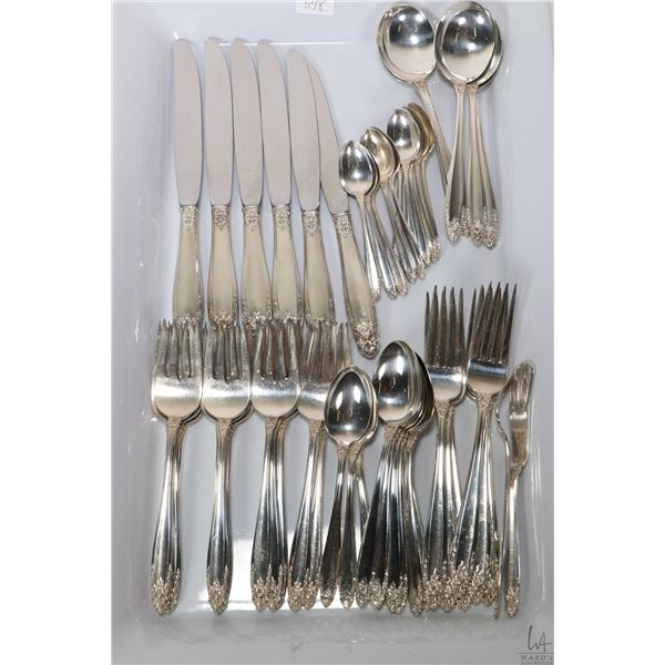 Tray lot of International Prelude sterling silver flatware including six each of table knives, dinne