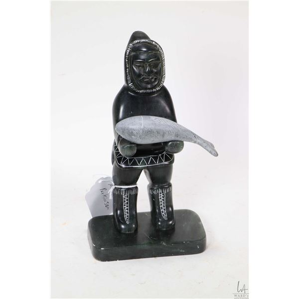 Inuit style soapstone carving of a fisherman with his catch signed by Quebec artist Mark Parkinson