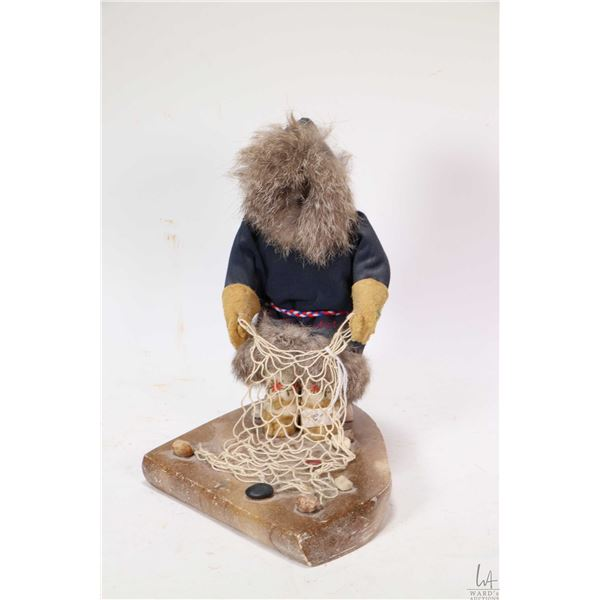 Hand crafted Inuit figure constructed with fur, leather and textiles depicting fisherman with his ne