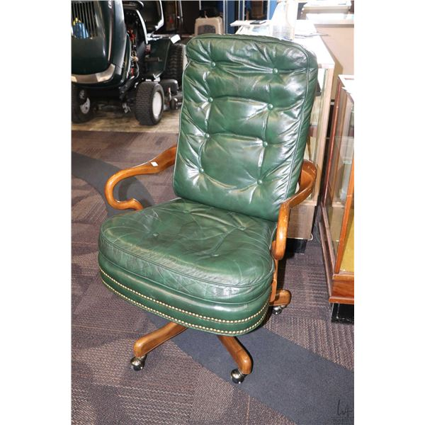 Green leather open arm swivel office chair with nail head decoration made by Drexel Heritage