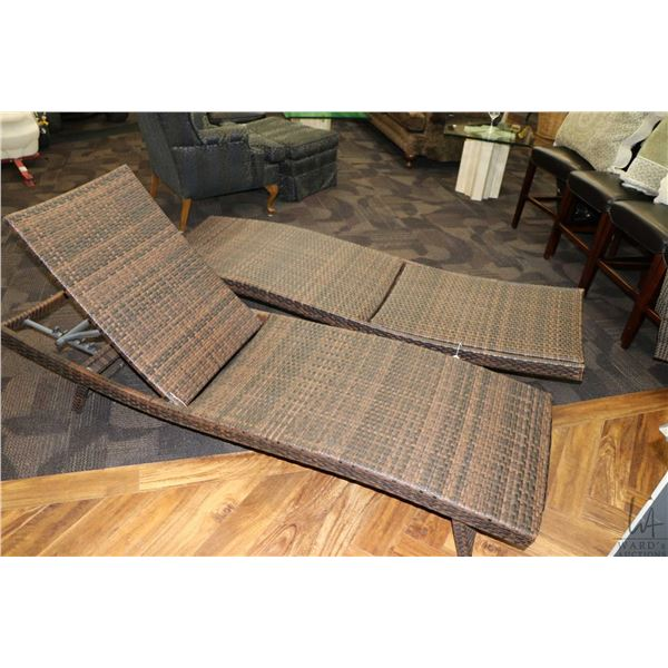Pair of Andersen & Stokke woven four position lounge chairs