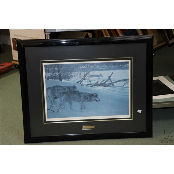 """Framed limited edition print titled """"Wolf Pack in Moonlight"""", pencil signed by artist Robert Bateman"""