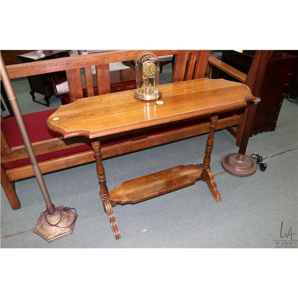 Mid 20th century walnut sofa table with under shelf