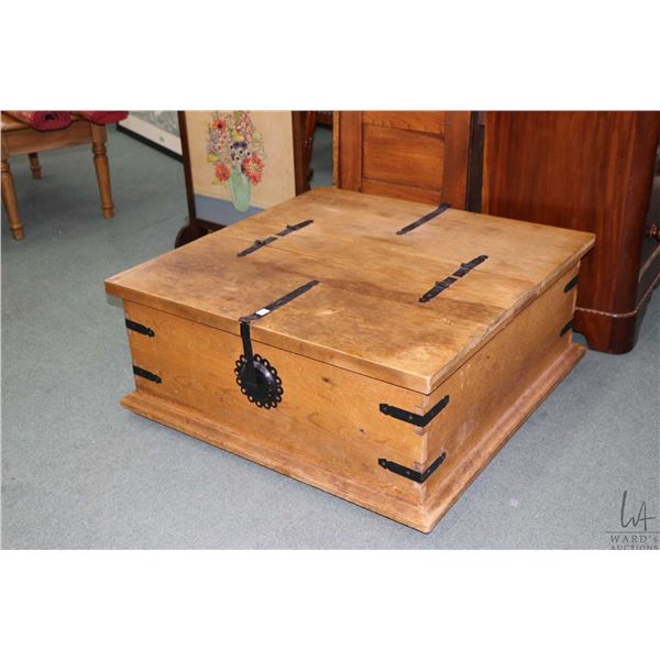 Antique style coffee table with simulated hand hammered hardware, lid lifts in two section and is hi