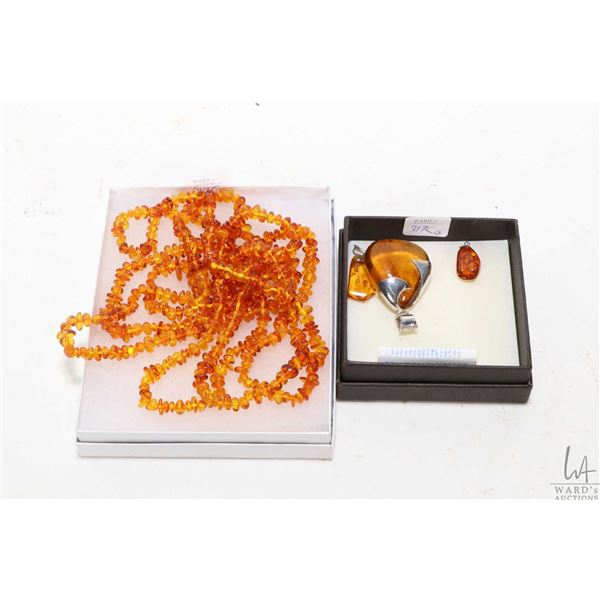 """Long 72"""" beaded amber like necklace plus a sterling silver and amber pendant and a small amber penda"""