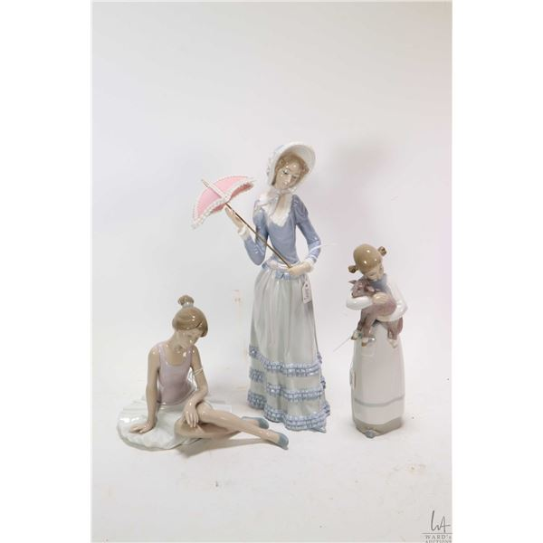 """Two Lladro figurines including a lady with parasol K13 M 12"""" in height, girl with lamb N-17 B and Ll"""