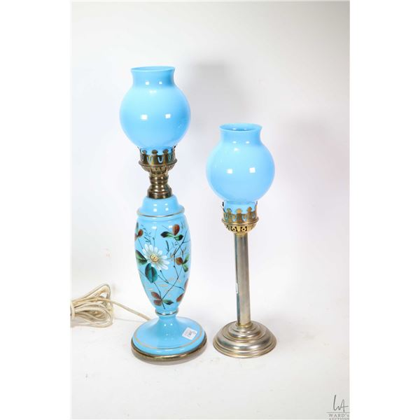 Hand painted blue glass electric table lamp and a brass coloured candlestick with matching blue glas